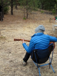 playing guitar in the campground