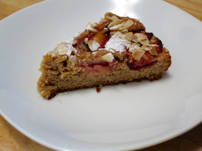 Slice of almond and plum cake
